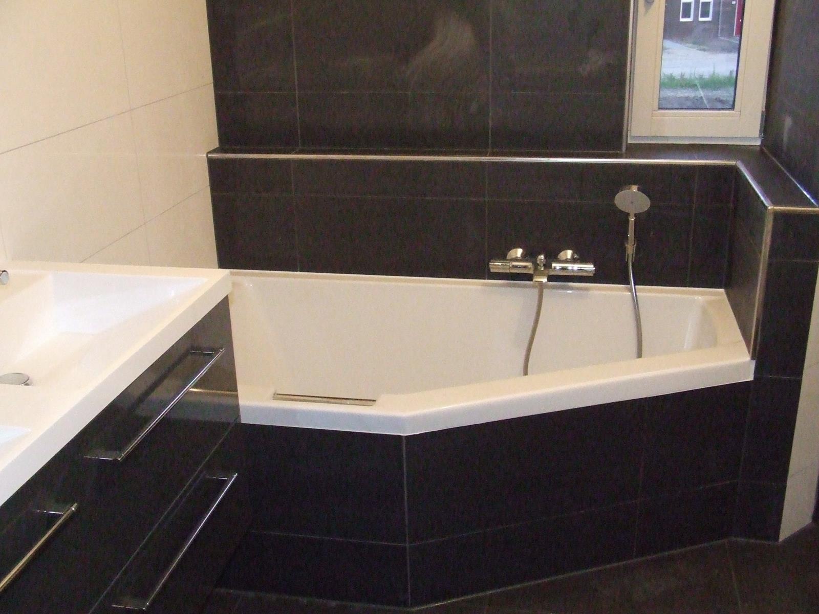 Kosten Betegelen Tuin : Betegelen badkamer kosten